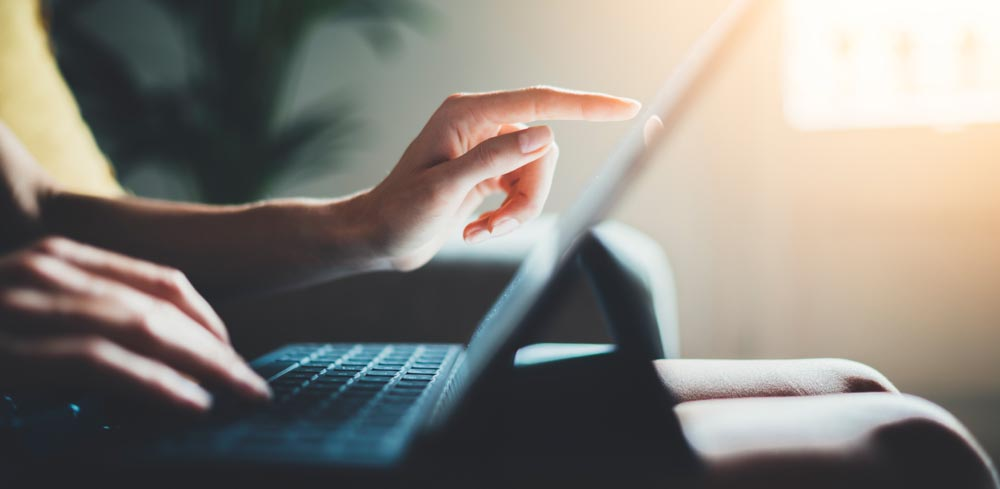 image of person using laptop computer